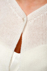 Bridal jacket with button in the front area