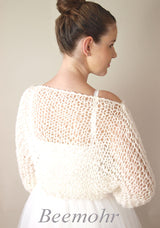 Wool and knitting instructions for a bridal sweater