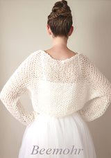 Wool and knitting instructions for a knitted sweater