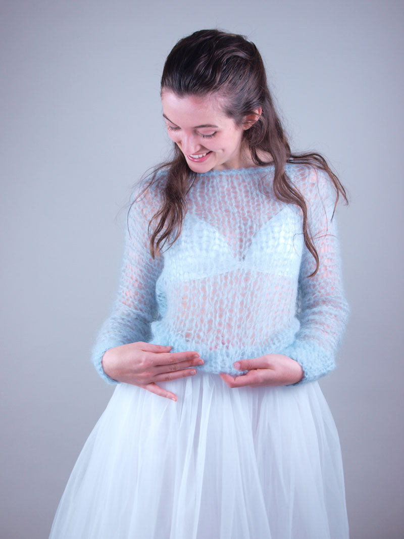 Wedding sweater knitted in look through soft wool