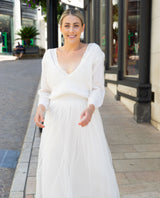 Knitted sweater with a deep neckline for the wedding