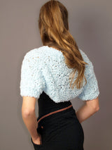Knitted bolero made of soft wool for flower children and brides