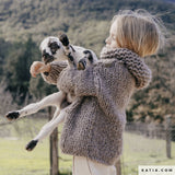 Knitted sweater for children made of Katia wool in gray