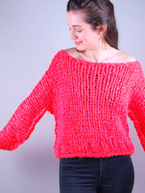 Neon pink sweater to knit yourself
