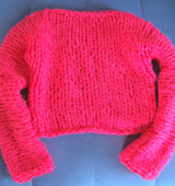 Children's knitted sweater in bright pink