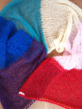 Pride Fashion knitted a pashmina in the colors of the rainbow