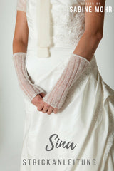 Cuffs in lace look to knit yourself