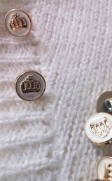 Buttons in gold and white