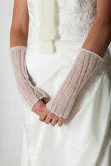 Cuffs knitted in lace pattern