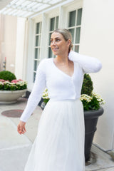 Ivory tulle skirt knitted for the bride with a cozy jacket