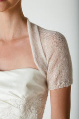 Knitted short-sleeved jacket made of CASHMERE for festive occasions