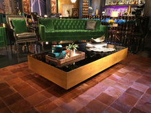 MOORE BLACK GLASS AND BRASS COFFEE TABLE