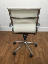 WHITE LEATHER SWIVEL CHAIR WITH CHROME ROLLER LEGS