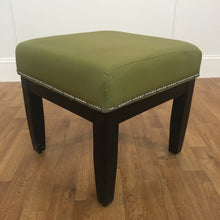 GREEN CLOTH OTTOMAN WITH BLACK WOOD LEGS