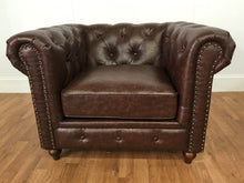 BROWN LEATHER LIVING ROOM CHAIR