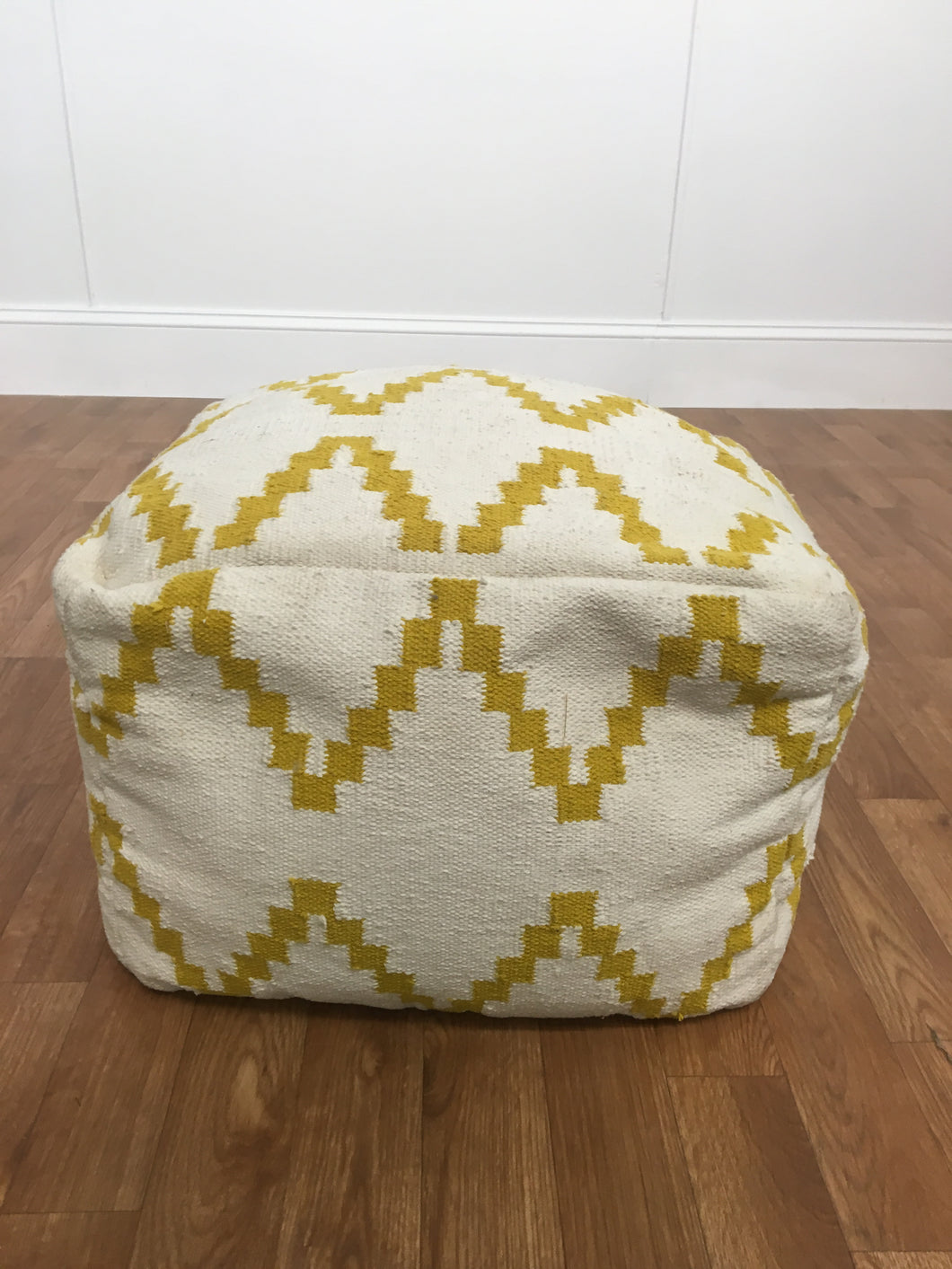SOFT GOLD AND WHITE CLOTH OTTOMAN