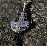 Functional Climbing Cam anchor Pendant - Handmade in sterling - silver - Edge view - Rock background
