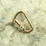 functional miniature carabiner lock solid 14k yellow gold rock background