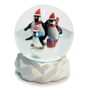 Penguin Parade Snowglobe - Talking Tables EU Public