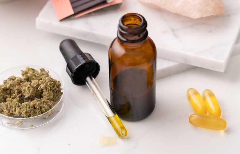 Image of cannabis oil, flower and capsules