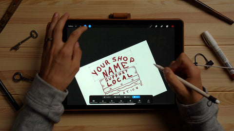person drawing a squeegee design on an ipad