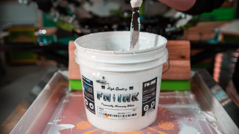 A bucket of FN-INK white ink sitting on a screen