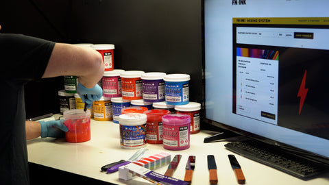 person mixing ink with the fn-ink mixing software on their computer