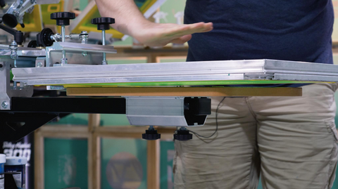 screen tilted on press with person demonstrating the tilt with their hand