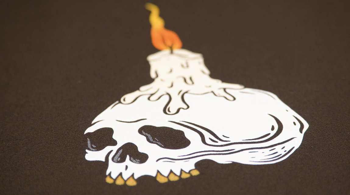 print of candle burning on a skull