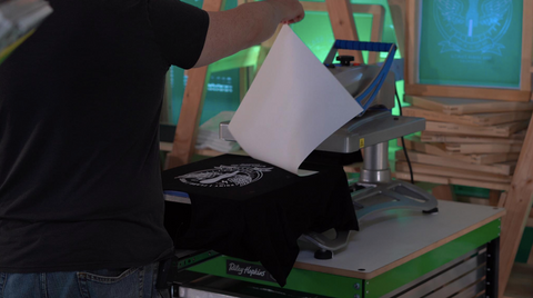 colin pulling the transfer paper off the print