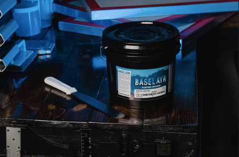 baselayr plastisol emulsion on a table next to a spatula
