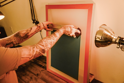 person coating a screen