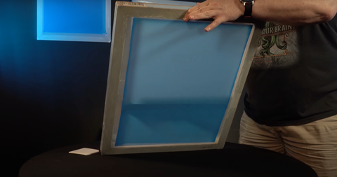 A screen being coated with Baselayr Plastisol emulsion