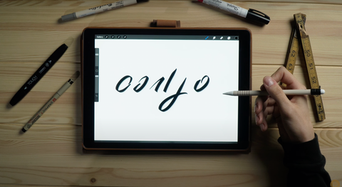 A hand draws 6 basic shapes in hand lettering