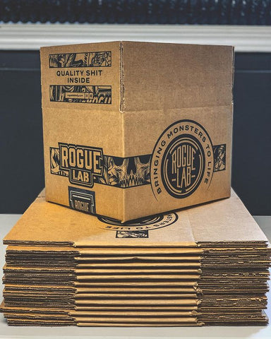 customized cardboard boxes flattened and stacked with one box folded up on top