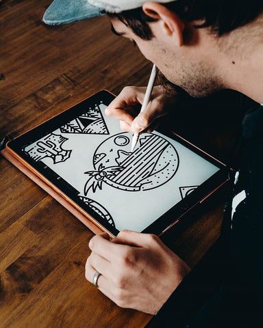 cory drawing a sunset on his ipad