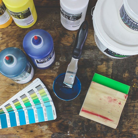 A pantone mixing system with supplies and a squeegee