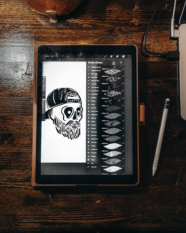 an ipad with a skull drawn on it in procreate