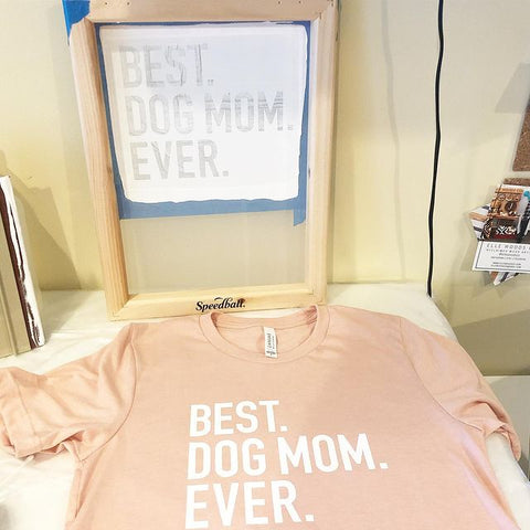 a screen above a shirt that says best dog mom ever