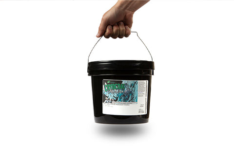 person holding a bucket of emulsion