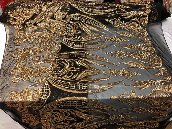 GOLD ROYALTY DESIGN EMBROIDERY WITH SEQUINS ON A BLACK 4 WAY STRETCH MESH.