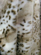 Load image into Gallery viewer, Wild Animal design faux/fake fur fabric. Sold by the yard.