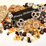 Halloween Snacks include mini chocolate chip cookies, chocolate covered decorated Oreo's, cakebites, popcorn, crispy rice treats.