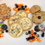 Gluten Free Halloween Treat assortment, sugar cookies, chocolate chip cookies, chocolate covered oreos, Rice Crisp treats, popcorn, all gluten free.