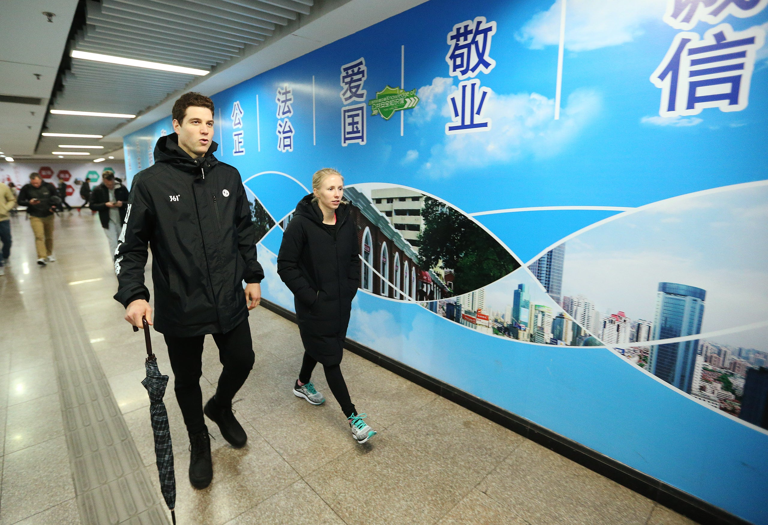 Jeffrey D. Allred, Deseret News Jimmer Fredette walks with his wife Whitney to the metro in Shanghai, China, on Jan. 20, 2018. Fredette is a former BYU Cougar and now plays for the Shanghai Sharks in the Chinese Basketball Association.