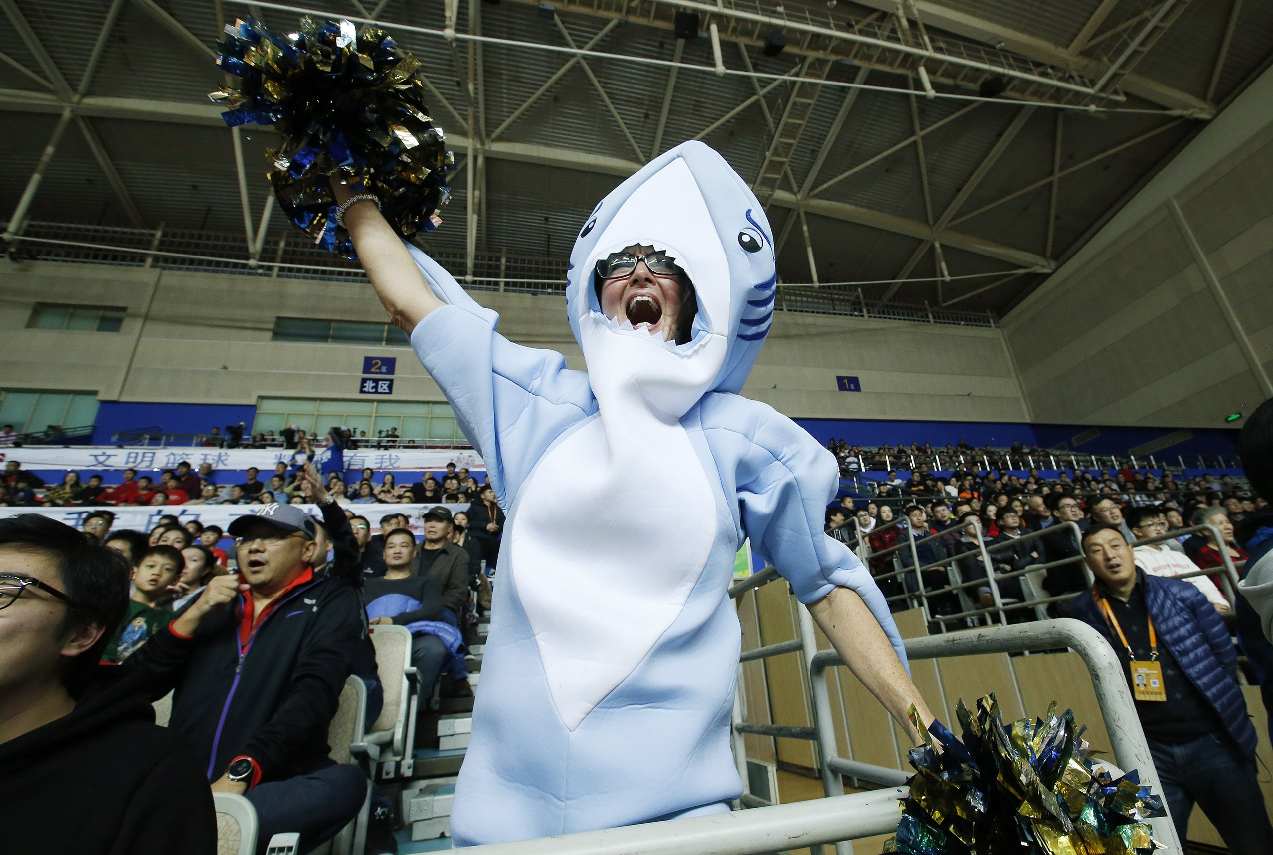 Jeffrey D. Allred, Deseret News Molly Raatz dons a shark costume and cheers on the Shanghai Sharks as they play the Bayi Rockets in Shanghai, China, on Jan. 21, 2018.