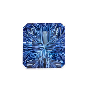 "21.85 carat Tanzanite (Concave ""fantasy"" emerald cut)"