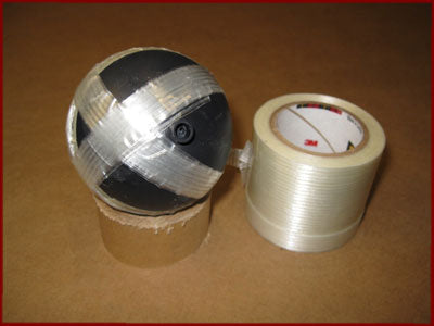 Third band of strapping tape on fireworks shell