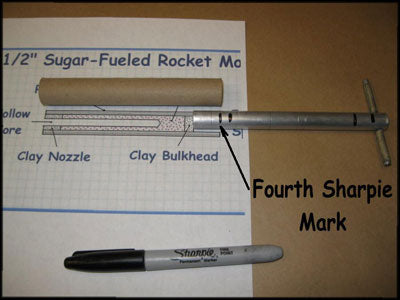 sugar rocket tooling with 4th alignment mark on rammer