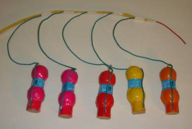 A Quickmatched chain of festival balls. Visco fuse is on the right side